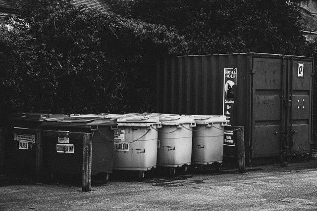 grayscale-photography-of-trash-bins-2952809